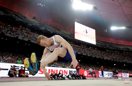 Britain's Greg Rutherford competes in the final of the men's long jump at the World Athletics Championships at the Bird's Nest stadium in Beijing, Tuesday, Aug. 25, 2015. (AP Photo/Andy Wong)