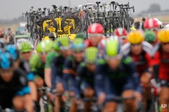 Spare bicycles and spare gyres sit on the roof of the team cars as they follow the pack during the fifth stage of the Tour de France cycling race over 189.5 kilometers (117.8 miles) with start in Arras and finish in Amiens, France, Wednesday, July 8, 2015. (AP Photo/Laurent Cipriani)