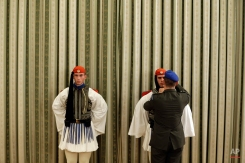 A military officer prepares the presidential guards, Evzones, before a swearing in ceremony of the leftwing leader Alexis Tsipras as prime minister in Athens on Monday, Sept. 21, 2015. Tsipras, who†won a convincing general election victory on Sunday, took a secural oath of office. (AP Photo/Thanassis Stavrakis)