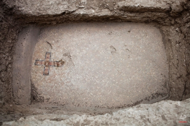 A mosaic floor featuring a cross is seen at an archaeological site at Ben Shemen Forest near the Israeli city of Modiin on Monday, Sept. 21, 2015. Amit Reem, an Israeli archaeologist working for the Israel Antiquities Authority, said the cross is a clue. It appears on the floor of a burial niche at the site. It is the only Byzantine-era site where a cross decorates the floor of a burial vault, he said, indicating that it may have marked the spot of an important figure. (AP Photo/Dan Balilty)