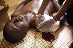 A protester who was shot during clashes is treated in a hospital in Ouagadougou, Burkina Faso, Thursday, Sept. 17, 2015. The protester later died. While gunfire rang out in the streets, Burkina Fasoís military took to the airwaves Thursday to declare it now controls the West African country, confirming that a coup had taken place just weeks before elections. (AP Photo/Theo Renaut)