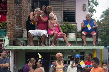 Residents wait for Pope Francis to drive past in the popemobile on his way to the pilgrimage site Hill of the Cross, in Holguin, Cuba, Monday, Sept. 21, 2015. Francis is ending his time in Holguin by blessing Cuba's fourth-largest city from the pilgrimage site overlooking the city. (AP Photo/Enric Marti)