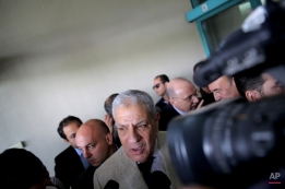 Acting Egyptian Prime Minister Ibrahim Mehleb speaks to journalists after his visit to injured Mexican tourists at the Dar Al Fouad Hospital in Cairo, Egypt, Monday, Sept. 14, 2015. At least 12 people were killed and 10 injured in Egypt's southwestern desert Sunday, Sept 13, 2015, when security forces mistakenly fired on a group of Mexican tourists on a safari trip, Egyptian officials said. The Mexican Foreign Ministry confirmed the incident and said at least two of the dead were Mexican nationals. (AP Photo/Nariman El-Mofty)