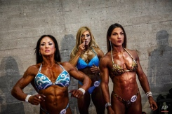 A competitor applies lipstick while waiting with other competitors at the backstage of the Arnold Classic Europe bodybuilding event in Madrid, Spain, Friday, Sept. 25, 2015. (AP Photo/Daniel Ochoa de Olza)