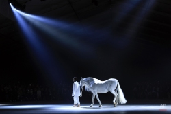 French fashion designer Simon Porte leads a horse on the catwalk, during Jacquemus' Spring-Summer 2016 ready-to-wear fashion collection, in Paris, Tuesday, Sept. 29, 2015. (AP Photo/Thibault Camus)