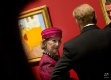 """Norway's Queen Sonja, center, listens to Van Gogh Museum director Axel Ruger, right, and Oslo's Munch Museum director Stein Olav Henrichsen, second right, as they pass Van Gogh's """"The Bedroom"""", rear, when officially opening the exhibit """"Van Gogh : Munch"""" at the Van Gogh museum in Amsterdam, Netherlands, Wednesday, Sept. 23, 2015. The exhibit opens to the public on Sept. 25 and runs till Jan. 17, 2016, and aims at showing the parallels between two iconic artists, Dutch Vincent van Gogh and Norwegian Edvard Munch. (AP Photo/Peter Dejong)"""