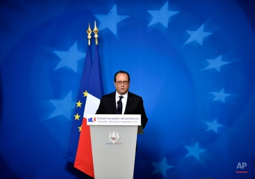 French President Francois Hollande talks to the media after the emergency EU heads of state summit on the migrant crisis at the EU council building in Brussels on early Thursday, Sept. 24, 2015. European Union leaders, faced with a staggering migration crisis and deep divisions over how to tackle it, managed to agree early Thursday to send 1 billion euros ($1.1 billion) to international agencies helping refugees at camps near their home countries. (AP Photo/Martin Meissner)