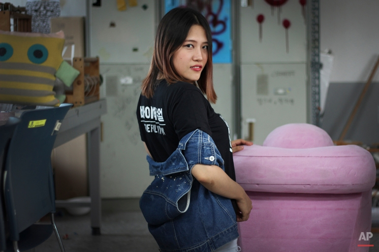 """In this Aug. 17, 2015, photo, You Han-sol, 24, poses for a photograph in her art studio at Sangmyung University in Seoul, South Korea, where she is working on her senior thesis project. You, who identifies as bisexual, said attending an all-girls middle school and high school made it difficult for her to explore her identity because she would be judged and shunned by her peers. Now out to her family and friends, she considers herself fortunate, even though she doesn't have 100 percent support from her family. """"My parents still hope that I will change and marry a decent guy she said. (AP Photo/Julie Yoon)"""