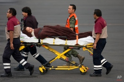 A Mexican woman, who was wounded in an attack by the Egyptian army while traveling in Egypt, is transferred from her return flight to a waiting helicopter at the presidential hangar of Benito Juarez International Airport in Mexico City, Friday, Sept. 18, 2015. Eight other Mexicans died Sunday when Egyptian forces hunting militants mistakenly attacked their convoy in the western desert. Four other people died in the attack on the convoy, which was led by Egyptian guides. Their nationalities were not confirmed. (AP Photo/Rebecca Blackwell)