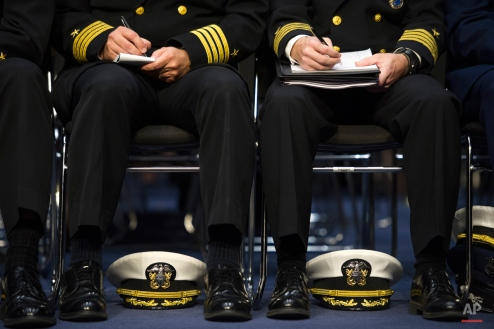 Aides to Adm. Harry Harris, Jr., US Navy Commander, U.S. Pacific Command, take notes while he testifies on Capitol Hill in Washington, Thursday, Sept. 17, 2015, before the Senate Armed Services Committee hearing on maritime security strategy in the Asia-Pacific region5. (AP Photo/Cliff Owen)