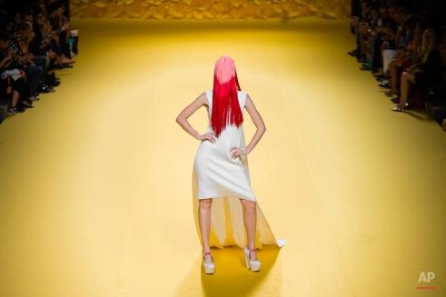 A model displays a 2016 Spring/Summer design by Agatha Ruiz De La Prada at the Madrid's Fashion Week in Madrid, Spain, Friday, Sept. 18, 2015. (AP Photo/Daniel Ochoa de Olza)