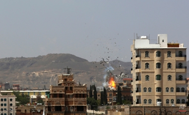 Debris and smoke rise after a Saudi-led airstrike hits an army base in Sanaa, Yemen, Monday, Sept. 14, 2015. Saudi Arabia is leading a coalition of mainly Gulf nations fighting Shiite Yemeni rebels known as the Houthis, who are allied with army units loyal to former President Ali Abdullah Saleh. (AP Photo/Hani Mohammed)