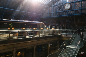 A girl runs up stairs leading to a concourse at St. Pancras railway station, central London, Wednesday, Sept. 2, 2015 as a Eurostar train awaits departure. The station, which first opened on Oct. 1, 1868, underwent major renovations between 2001 and 2007. (AP Photo/David Azia)