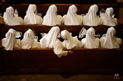 Nuns sit in their pews while waiting for Pope Francis to arrive inside the Basilica of the National Shrine of the Immaculate Conception Wednesday, Sept. 23, 2015, in Washington. (AP Photo/David Goldman)
