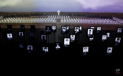 Pictures of Argentine soldiers who died in the Falklands War between Argentina and Great Britain are displayed inside Malvinas Museum in Buenos Aires, Argentina, Friday, Sept. 18, 2015. Argentine veterans of the Falklands War have welcomed the declassification of secret documents officially confirming long sought after acknowledgment of abuse and torture at the hands of their own superiors. The accounts include claims that military superiors tortured them by leaving them in burial pits, withholding food and giving them electric shocks. (AP Photo/Natacha Pisarenko)