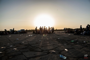 Refugees rest at a collecting point in the village of Tovarnik near the border between Serbia and Croatia, Thursday, Sept. 17, 2015. Croatia has suddenly become the latest hotspot in the 1,000-mile plus exodus toward Western Europe after Hungary sealed off its border Tuesday with a razor-wire fence and then used tear gas, batons and water cannons to keep the migrants out. (AP Photo/Manu Brabo)