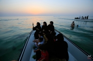 Bahrainis head out for a boat ride on the Persian Gulf with children holding baskets of sprouting greens to throw in the water, a traditional way Bahraini Muslims celebrate the Eid al-Adha holiday, Wednesday, Sept. 23, 2015, in Malkiya, Bahrain. Traditionally, children plant their baskets several days ahead of the holiday, then throw them into the sea as a small sacrifice of the plants they tended. Muslims around the world are celebrating Eid al-Adha, or the Feast of the Sacrifice, to commemorate the prophet Abraham's willingness to sacrifice his son for God. (AP Photo/Hasan Jamali)