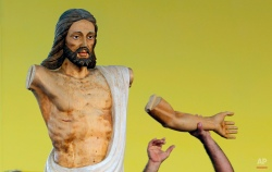A worker prepares to fit a wooden arm onto a Christ statue during preparations of the altar where Pope Francis will celebrate Mass in the Plaza of the Revolution, in Havana, Cuba, Thursday, Sept. 17, 2015. When Francis arrives in Havana on Sept. 19, he'll find his church ministering to more Cubans than at any time since the 1959 revolution that brought Fidel Castro to power. (AP Photo/Desmond Boylan)