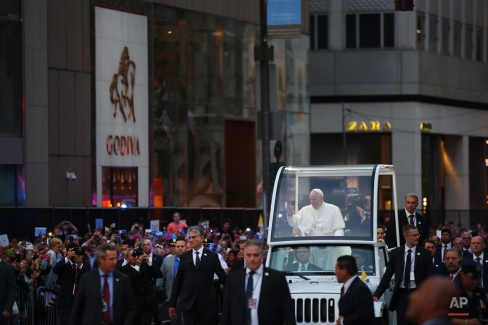 Pope Francis rides in the pope mobile on Fifth Avenue as he arrives at St. Patrick's Cathedral, Thursday, Sept. 24, 2015 in New York. (Damon Winter/The New York Times via AP, Pool)