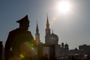 Policemen prepare security gates before the beginning of the re-opening ceremony of the newly restored Moscow Cathedral Mosque in Moscow, Russia, Wednesday, Sept. 23, 2015. The mosque was demolished and rebuilt to be one of the biggest mosques in the country with a room for 10,000 believers. Russian President Vladimir Putin, Turkey's President Recep Tayyip Erdogan and Palestinian President Mahmoud Abbas will join the re-opening ceremony of the mosque later in the day. (AP Photo/Alexander Zemlianichenko Jr.)