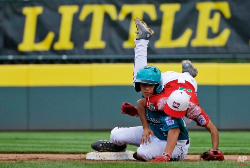 Venezuela's Jose Grateron, left, collides with Mexico's Andres Villa after Grateron was forced out at second base on a double play hit into by Angel Uranga during the fifth inning of an International elimination baseball game at the Little League World Series, Thursday, Aug. 27, 2015, in South Williamsport, Pa. Mexico won 11-0. (AP Photo/Matt Slocum)