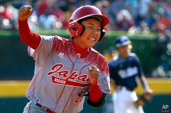 Japan's Masafuji Nishijima, left, rounds third after hitting a three-run home run off Lewisberry, Pa.'s Jaden Henline in the third inning of the Little League World Series Championship baseball game in South Williamsport, Pa., Sunday, Aug. 30, 2015. (AP Photo/Gene J. Puskar)