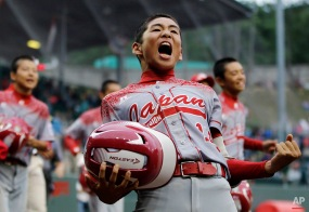 Japan's Kengo Tomita reacts after Yugo Aoki hit a game-winning RBI single off Venezuela's Johan Garcia during the eighth inning of an international double-elimination baseball game at the Little League World Series, Wednesday, Aug. 26, 2015, in South Williamsport, Pa. Japan won 5-4. (AP Photo/Matt Slocum)