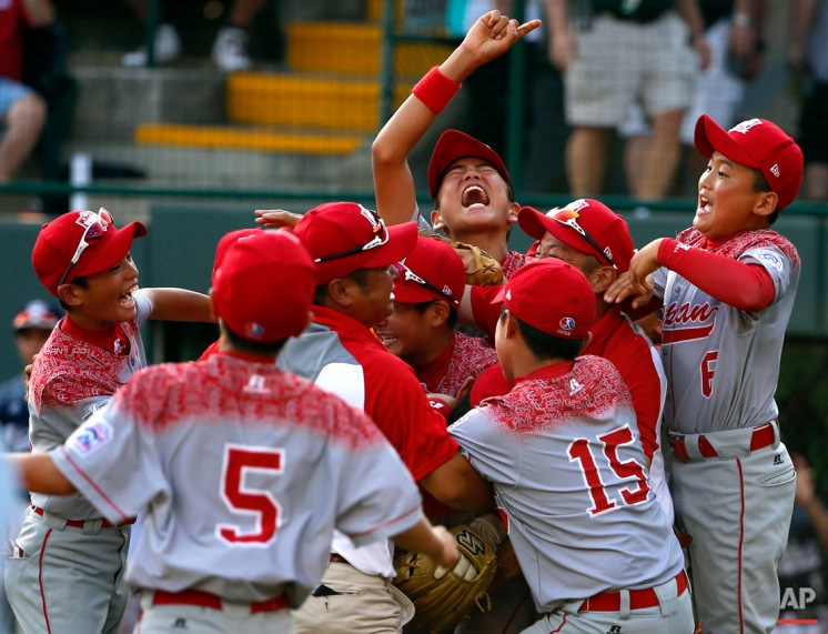 Japan celebrates after winning the Little League World Series Championship baseball game over Lewisberry, Pa. in South Williamsport, Pa., Sunday, Aug. 30, 2015. Japan won 18-11. (AP Photo/Gene J. Puskar)