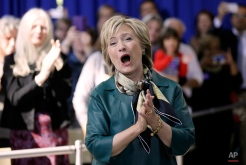 Democratic presidential candidate Hillary Rodham Clinton reacts to a supporter before speaking at a community forum, Tuesday, Oct. 6, 2015, in Davenport, Iowa. (AP Photo/Charlie Neibergall)