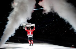 Chicago Blackhawks' Niklas Hjalmarsson skates out to center ice with the Stanley Cup during a Stanley Cup championship banner raising ceremony before an NHL hockey game between the Blackhawks and the New York Rangers Wednesday, Oct. 7, 2015, in Chicago. (AP Photo/Charles Rex Arbogast)