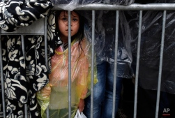 A migrant girl waits to register with the police at a refugee center in the southern Serbian town of Presevo, Wednesday, Oct. 7, 2015. Several Eastern European countries are cooperating on controlling the flow of migrants at the external borders of the European Union ó a program a top Hungarian official said Tuesday could set an example for the rest of the 28-nation bloc. (AP Photo/Darko Vojinovic)