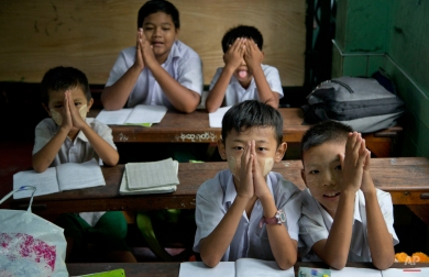 Students of a Buddhist monastic school observe Buddhist rituals before commencing studies in Yangon, Myanmar, Friday, Oct. 9, 2015. Monastic schools founded by the monks largely depend on the private donations to provide education for over 150,000 children all over Myanmar. (AP Photo/Gemunu Amarasinghe)