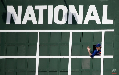 New York Mets starting pitcher Jacob deGrom waves from the scoreboard Monday, Oct. 19, 2015, during a team workout in preparation for Tuesday's Game 3 in baseball's National League Championship Series against the Chicago Cubs in Chicago. (AP Photo/Charles Rex Arbogast)