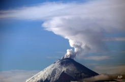 The Cotopaxi volcano spews ash and vapor, as seen from Quito, Ecuador, Monday, Oct. 19, 2015. Cotopaxi began showing renewed activity in April and its last major eruption was in 1877. (AP Photo/Dolores Ochoa)