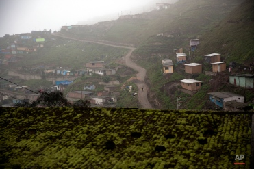 A man walks on a dirt road in the Villa Maria del Triunfo neighborhood, on the outskirts of Lima, Peru, Tuesday, Oct. 6, 2015. One of the Peruvian economyís biggest problems is structural. Economists say little or nothing was done to diversify it during the commodities boom and to invest in building technological literacy. The annual meetings of the World Bank Group and the International Monetary Fund are taking place in Peru on Oct. 6-11, a country that according to the World Bank, has been able to reduce its poverty rate by more than half since 2002 . (AP Photo/Rodrigo Abd)