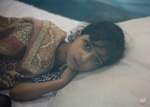 A Pakistani girl suffering from dengue fever rests in an isolation ward at a local hospital in Rawalpindi, Pakistan, Monday, Oct. 5, 2015. Hundreds of dengue patients with the mosquito-borne disease have registered in Rawalpindi, health official said. Dengue, a flu-like illness spread by the Aedes mosquitos, spikes during the annual monsoons, when the rains leave puddles of stagnant water where the insects breed. (AP Photo/B.K. Bangash)