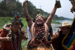 Shamans perform a ritual asking for protection from the natural phenomenon known as El Nino, on the outskirts of Lima, Peru, Thursday, Oct. 1, 2015, where the government has already declared a pre-emptive emergency to prepare for devastating flooding. Every few years, the winds shift and the water in the Pacific Ocean gets warmer than usual. That water sloshes back and forth around the equator in the Pacific, interacts with the winds above and then changes weather worldwide. Peruvian sailors named the formation El Ninoóthe (Christ) Childóbecause it was most noticeable around Christmas. (AP Photo/Martin Mejia)