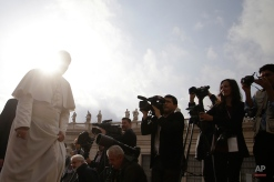 Pope Francis arrives in St. Peter's Square for the weekly general audience, at the Vatican, Wednesday, Oct. 14, 2015. Pope Francis is asking forgiveness for recent scandals that have hit Rome and the Vatican. The pope didn't cite specific examples in his off-the-cuff request for pardon at the start of his Wednesday general audience. But the past week has seen its fair share of problems: On the eve of Francis' big meeting on the family, a Vatican monsignor came out as gay. Then Rome's mayor resigned amid scandal and criticism by the church. And recently, a leaked letter revealed grave concerns by a dozen cardinals about the way Francis' synod was being run. (AP Photo/Gregorio Borgia)