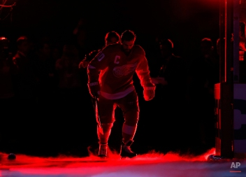 Detroit Red Wings left wing Henrik Zetterberg is introduced before in the first period of an NHL hockey game against the Toronto Maple Leafs in Detroit Friday, Oct. 9, 2015. (AP Photo/Paul Sancya)