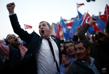 Supporters of Turkey's Justice and Development Party (AKP) celebrate as their leader and Turkish Prime Minister Ahmet Davutoglu arrives to deliver a speech during a rally, in Istanbul, Turkey, Wednesday, Oct. 7, 2015. Turkey goes to elections on Nov. 1, 2015. (AP Photo/Emrah Gurel)