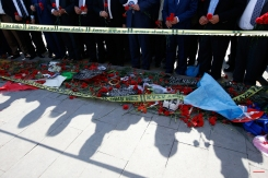 People gather at the site of the two explosions in Ankara, Turkey, to lay flowers for the victims, Tuesday, Oct. 13, 2015. The two suicide bombings in the capital came amid political uncertainty in the country ó just weeks before Turkey's Nov. 1 election.(AP Photo/Emrah Gurel)
