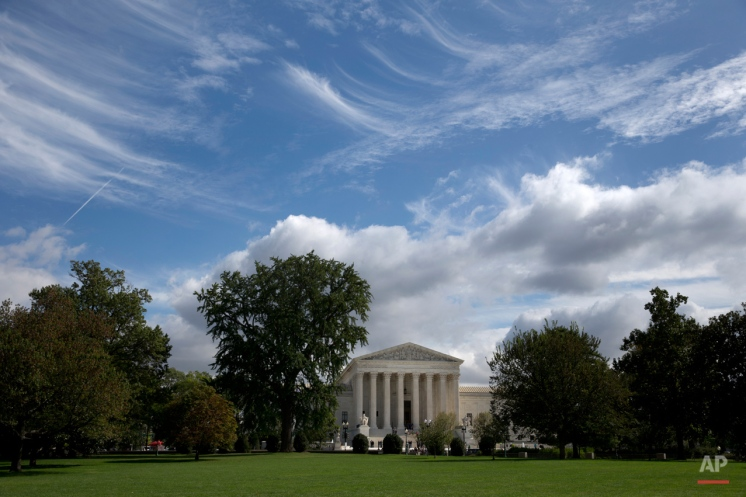 Cirrus clouds, left,, and cumulus clouds, right, are seen over the Supreme Court is seen in Washington, Monday, Oct. 5, 2015. The Supreme Court is starting a new term that promises a steady stream of divisive social issues, and also brighter prospects for conservatives who suffered more losses than usual in recent months. (AP Photo/Carolyn Kaster)