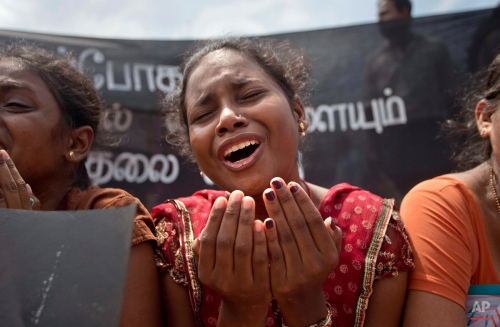 A family member of an ethnic Tamil detainee cries during a silent protest in Colombo, Sri Lanka, Wednesday, Oct. 14, 2015. Relatives and civil rights activists are demanding the Sri Lankan government to release hundreds of minority ethnic Tamils detained without charges for years on suspicion of links to the now-defeated Tamil Tiger rebels. (AP Photo/Eranga Jayawardena)