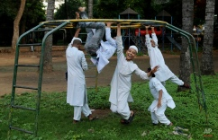 Indian Muslim children, who study at Jamia Masjid or the Grand Mosque, play at a ground in front of the mosque in Bangalore, India, Tuesday, Oct. 6, 2015. The chief cleric of Bangalore's main mosque said Tuesday that he has advised the heads of hundreds of mosques in India's technology hub to actively counter propaganda by extremist Islamic groups by reaching out to young people in colleges and on social media. (AP Photo/Aijaz Rahi)