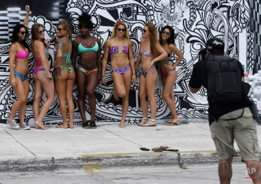 Beth Reeb, of St. Augustine, Fla., third from left, poses for a photograph with a group of women, Monday, Oct. 5, 2015, in the Wynwood neighborhood of Miami. Reeb designs Savage Swim swimwear and was having promotional photos taken of her swimwear. (AP Photo/Lynne Sladky)