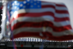 Sailors of U.S. navy nuclear-powered aircraft carrier USS Ronald Reagan man the rails upon arrival as some U.S. flag-shaped balloons are hoisted to welcome them at the U.S. Navy's Yokosuka base in Yokosuka, south of Tokyo Thursday, Oct. 1, 2015. An American nuclear-powered aircraft carrier USS Ronald Reagan has entered its new home in Japan's Yokosuka naval port, replacing its predecessor USS George Washington. The arrival Thursday comes just as Tokyo tries to deepen defense ties with the US under new security law.(AP Photo/Eugene Hoshiko)