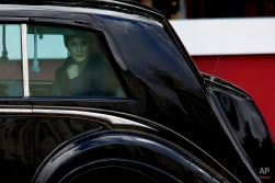 """Spain's Queen Letizia looks from inside a car as she leaves after a military parade during the holiday known as """"Dia de la Hispanidad"""" or Hispanic Day, in Madrid, Spain, Monday, Oct. 12, 2015. King Felipe has presided over a military parade celebrating Spain's National Day which 3,400 soldiers in crisp uniforms marched in central Madrid while armed forces aircraft performed a fly-past leaving trails of red and yellow smoke representing the Spanish flag. (AP Photo/Francisco Seco)"""