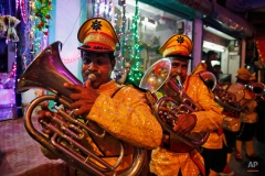 An Indian brass band members perform at a procession on the first day of the nine-day Navratri festival in Allahabad, India, Tuesday, Oct. 13, 2015. Feasting and fasting takes over normal life for millions of Hindus during Navratri, the festival of nine nights. (AP Photo/Rajesh Kumar Singh)