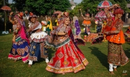 Indians wearing traditional attire practice Garba, the traditional dance of Gujarat state ahead of Hindu festival Navratri in Ahmadabad, India, Friday, Oct. 9, 2015. Navaratri, the festival of nights, lasts for nine days, with three days each devoted to the worship of Durga, the goddess of valor, Lakshmi, the goddess of wealth, and Saraswati, the goddess of knowledge. Feasting and fasting takes over normal life for millions of Hindus, and many people join in religious dances in the evenings. The festival will begin from Oct. 13. (AP Photo/Ajit Solanki)