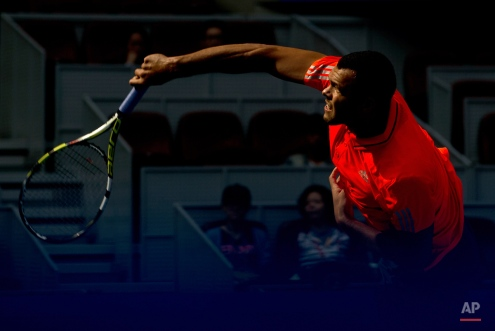 Jo-Wilfried Tsonga of France serves against Andreas Haider-Maurer of Austria during their first round match of the China Open tennis tournament at the National Tennis Stadium in Beijing, Monday, Oct. 5, 2015. (AP Photo/Andy Wong)